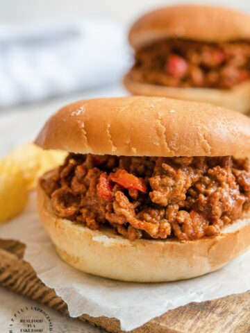 SLOPPY JOES - Ground beef, onions, peppers and spices together with a savory ketchup gravy served on hamburger buns #weeknightdinner #easymeals #happilyunprocessed