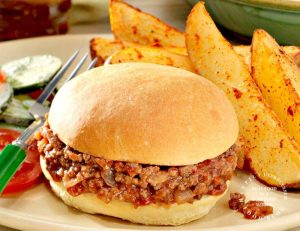 homemade sloppy joe on bun with steak fries on plate happily unprocessed