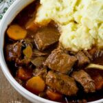 Traditional Irish Beef Stew with chunks of beef, carrots, onions, celery simmered in brown gravy #beef #stew #winterfood #healthy #happilyunprocessed
