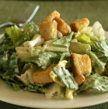 caesar salad with croutons on white plate