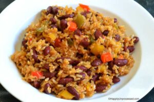 bowl of red kidney beans brown rice, spices and veggies