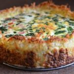 Spinach gruyere cheese quiche with hashbrown crust