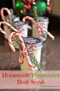 glass mason jar filled with homemade peppermint body scrub tied with fresh pine and candy cane