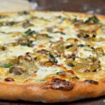 Caramelized Onion, Mushroom, Feta and Spinach Pizza with White Sauce