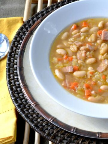 white bowl of white cannellini beans and ham soup
