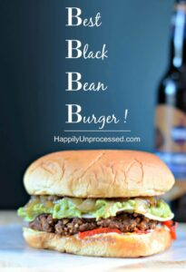 black bean burger topped with sauteed onions, guacamole lettuce with beer