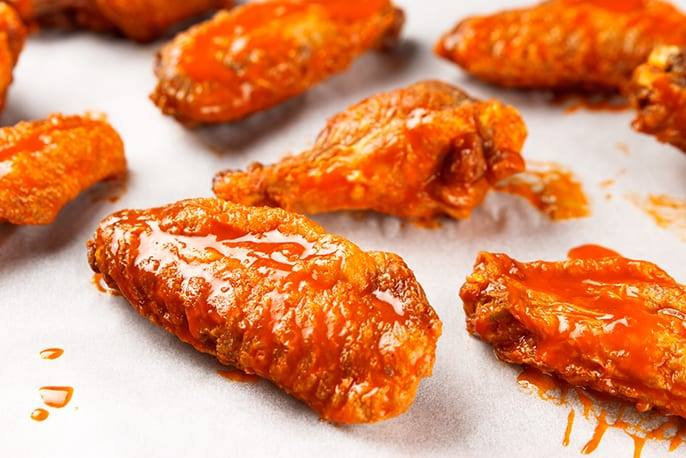 Get the spicy bar staple at home by roasting Alton Brown's Buffalo Wings recipe from Good Eats on Food Network.