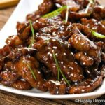 Mongolian beef on white plate