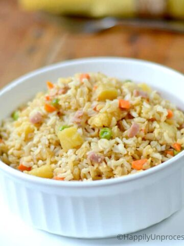 Pineapple Fried Rice with ham, peas, diced carrots in white bowl