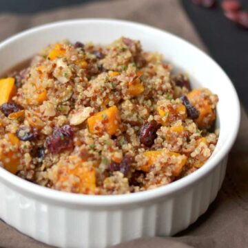 Roasted butternut squash and quinoa with craisins, slivered toasted almonds