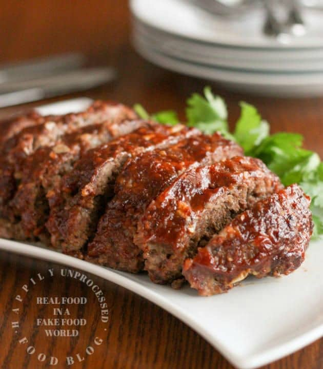 sliced meatloaf with honey whiskey bbq glaze on white plate