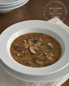 white bowl of mushroom barley soup happilyunprocessed