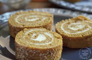 close up 3 slices pumpkin roll with cream cheese filling