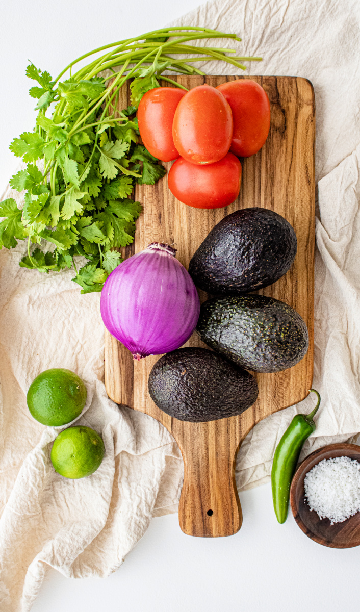 Homemade Guacamole ingredients avocado onion garlic lime cilantro - Wholly Guacamole (5 ingredients - 5 minutes)