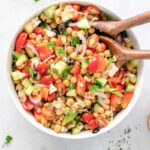 A Mediterranean Chickpea and Feta Salad in a bowl mixed with dressing 150x150 - Happily Unprocessed