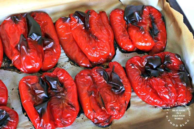 roasted red peppers cut in half on bakig sheet