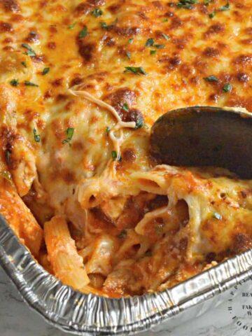 close up of cheey gooey tray of hot baked ziti