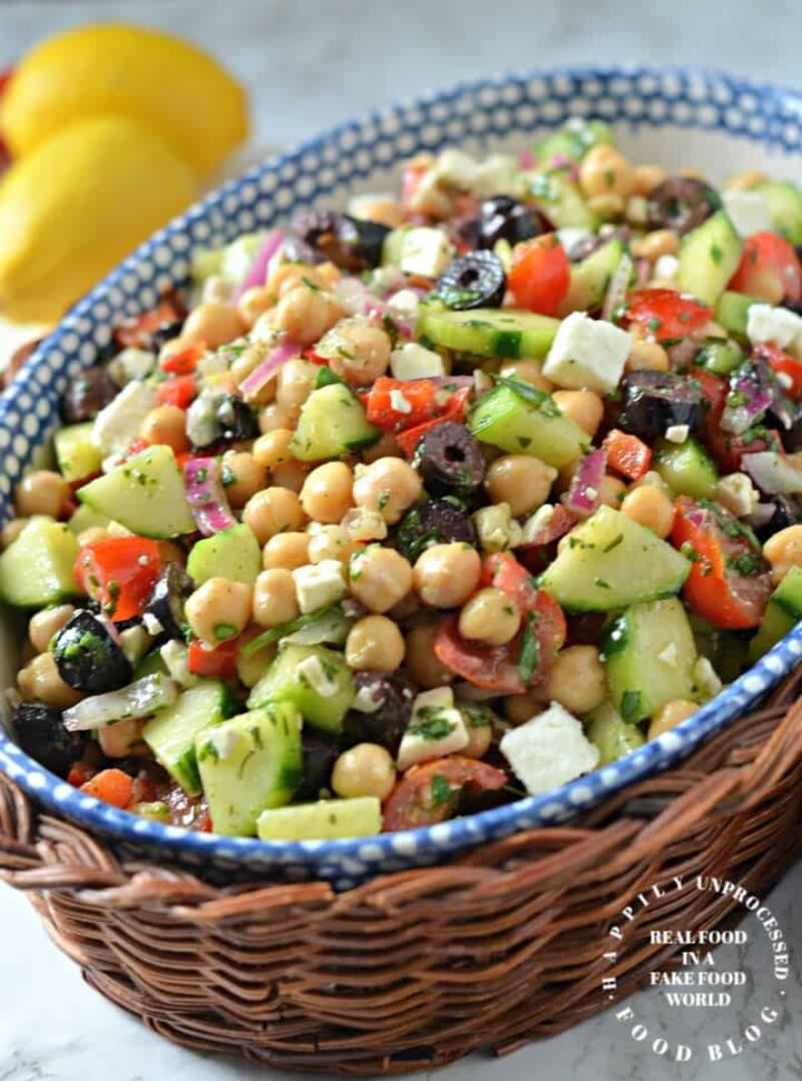 bowl with chickpeas, cucumbers, red peppers, kalamatta olives, feta cheese in vinaigrette dressing
