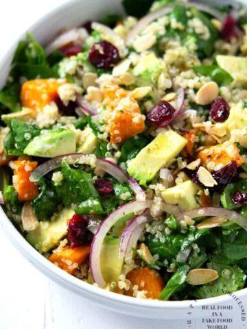 bowl of roasted sweet potato, spinach & quinoa salad