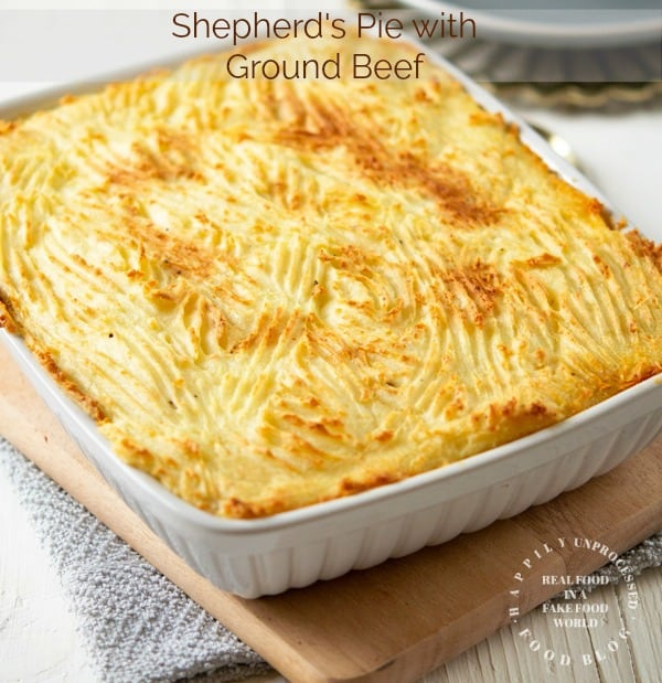 Freshly made Shepherds Pie in 9x13 white casserole dish topped with broiled mashed potatoes