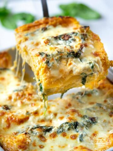 One slice of butternut squash and spinach lasagna pulled from pan