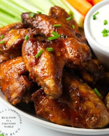 Slow Cooker Chicken wings in a tangy delicious honey buffalo sauce #chickenwings #buffalo #slowcooker #happilyunprocessed