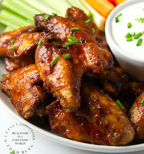 Fall off the Bone Crockpot Honey Buffalo Wings - no frying, no mess.  Slow cooked until tender and finished under the broiler with a tangy, spicy, delicious honey buffalo sauce #chickenwings #wings #football #gameday #appetizers #happilyunprocessed