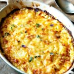 ROASTED GARLIC & CARAMELIZED ONION POTATOES DAUPINOISE - cheese potatoes au gratin but with roasted garlic and onions #potatoes #scalloped #sidedish #vegetarian #happilyunprocessed.com