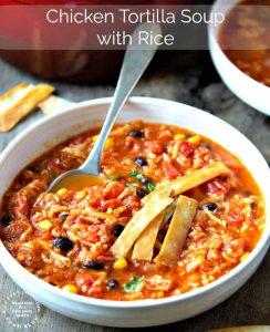 CHICKEN TORTILLA SOUP WITH RICE - perfect blend of Mexican spices, shredded chicken, corn, beans and rice for a filling bowl of soup #soup #chickentortilla #healthy #happilyunprocessed