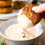 Roasted cauliflower fritters with a Bloomin Onion dipping sauce - roasting the cauliflower takes the water out as well as brings out that caramelized roasted flavor in these fritters #cauliflower #appetizer #vegetarian #happilyunprocessed