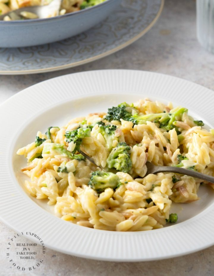 Creamy Cheddar & Broccoli Orzo - little orzo pasta is cooked in broth and married with a creamy cheesy sauce with little bits of broccoli #orzo #sidedish #healthy #happilyunprocessed.com