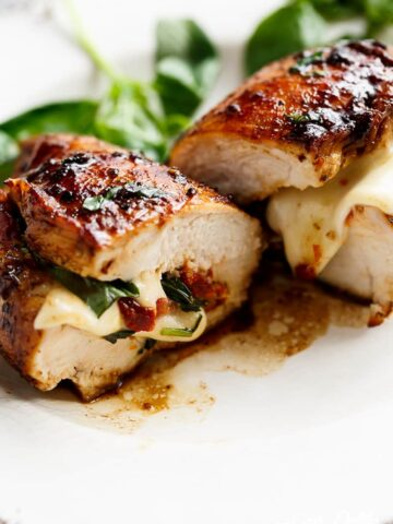 CAPRESE CHICKEN - Thin chicken breasts stuffed with sun dried tomatoes, mozzarella cheese topped with a sweet balsamic glaze #capresechicken #chicken #weeknightdinner #cleaneating #happilyunprocessed