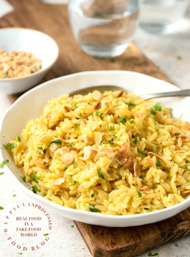 RICE PILAF WITH ORZO AND SLIVERED ALMONDS - No boxed rices! Homemade rice pilaf is the easiest side dish #rice #sidedish #orzo #happilyunprocessed