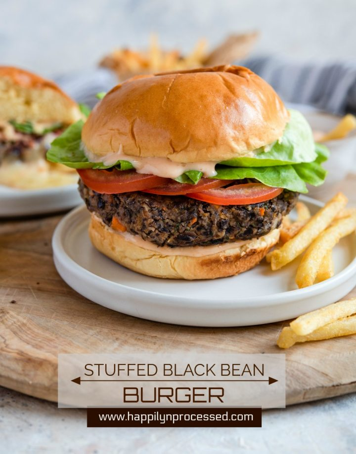 STUFFED BLACK BEAN BURGER with Monterey Jack Cheese - seasoned black beans, diced veggies, spices and cheese make up this delicious meat alternative burger #blackbeanburger #impossiblemeat #vegetarian #dinner #grill #happilyunprocessed