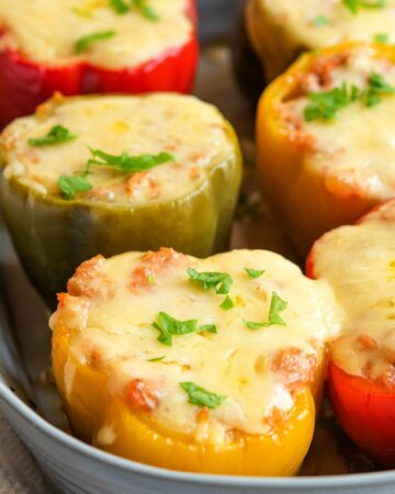 STUFFED PEPPERS WITH GROUND TURKEY AND CAULIFLOWER RICE - cutting back on red meat? These stuffed peppers are so delicious you may need to make more and freeze it #turkey #stuffedpeppers #weeknightdinner #happilyunprocessed.com