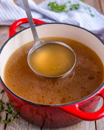 Crockpot Turkey Stock - don't throw away those leftovers. Bone broth is one of the healthiest stocks you can make #stock #bonebroth #turkey #thanksgiving