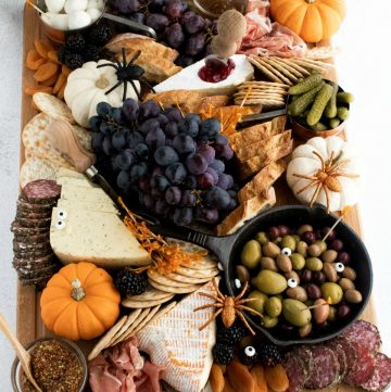 Fall Charcuterie Board with olives, cheeses, meats, pumpkins