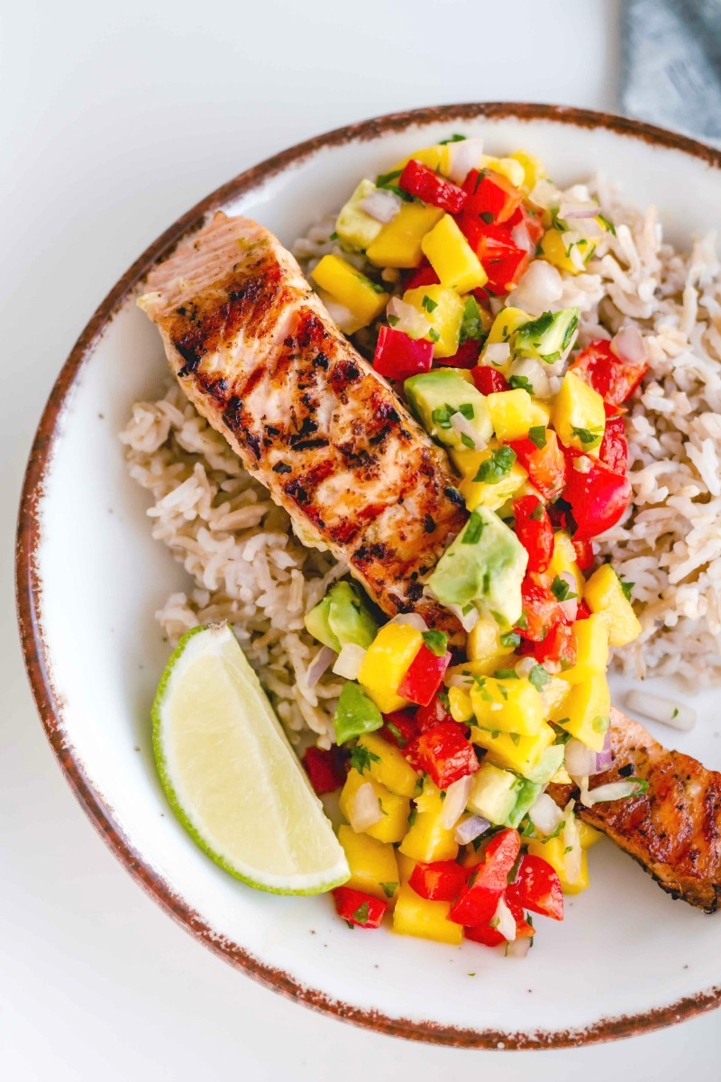 salmon with mango and avocado salsa brown rice and lime slice - Healthy Grilled Salmon with Lime Mango Salsa