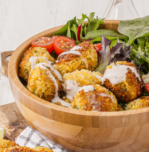 Delicious flavorful homemade Falafels in an epic sauce over greens - Falafel Bowls