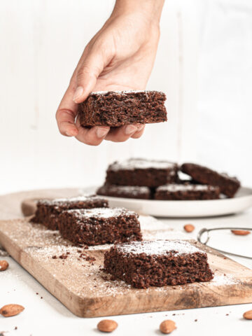 Healthy chocolate zucchini brownies with powdered sugar on top