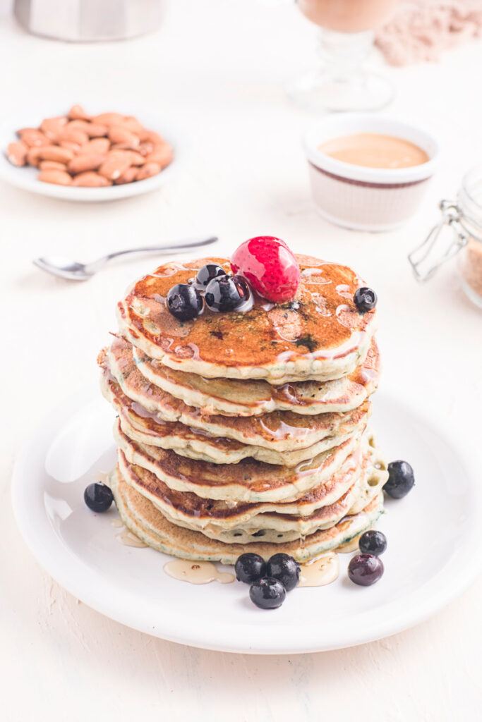 Homemade Blueberry Buttermilk Pancakes in a stack on a plate 683x1024 - Homemade Blueberry Buttermilk Pancakes