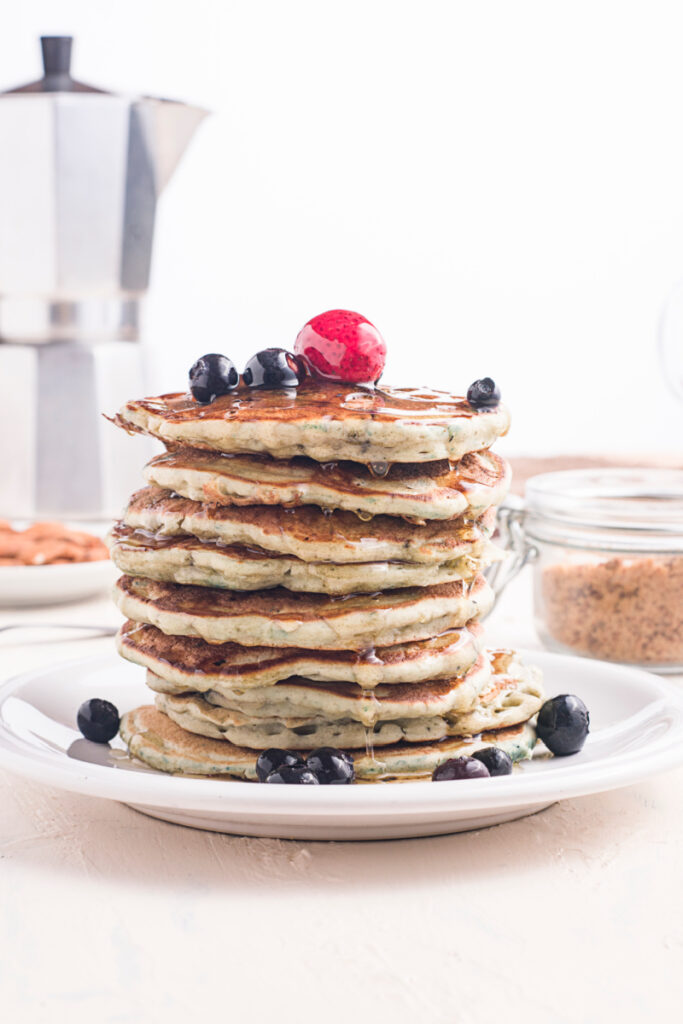 Homemade Blueberry Buttermilk Pancakes with syrup on a plate 683x1024 - Homemade Blueberry Buttermilk Pancakes