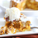 Instant Pot Pumpkin Bread Pudding on a plate with melted vanilla ice cream on top